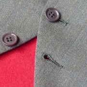 Vest button unbuttoned