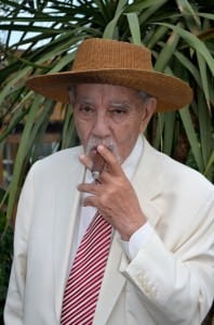 Avo Uvezian Off Whilte Brioni Suit and Straw Hat