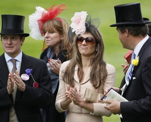 Elizabeth Liz Hurley at Royal Ascot with two gentlemen in morning coat and boutonniere