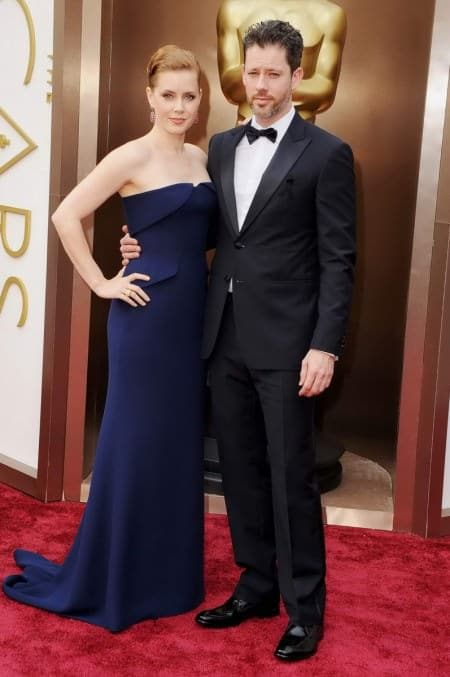 Amy Adams & Darren Le Gallo in black 2 button tuxedo with black ribbon, pleated shirt, pre-tied bow tie and 2 buttons.