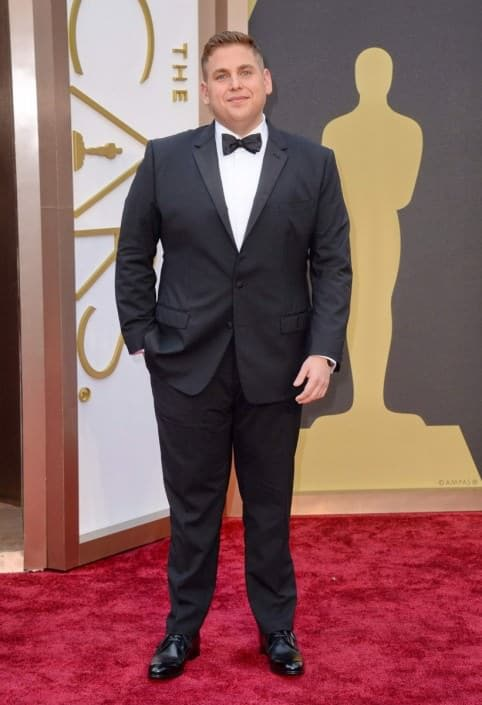 820da21c2f2 ... Jonah Hill in notched lapel tuxedo with flapped pockets, wristwatch and  derby shoes ...