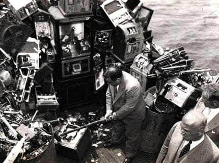 Fiorello LaGuardia Aboard a police boat on October 10, 1934, hammering on confiscated slot machine, which was about to be dumped into New York harbor