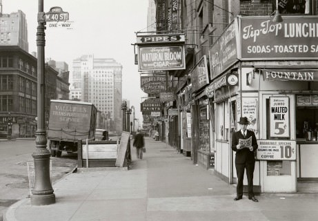 New York's 6th Ave & 40th St, Note the newpaper headline - Nazi Army Now 75 Miles From Paris, May 18, 1940.