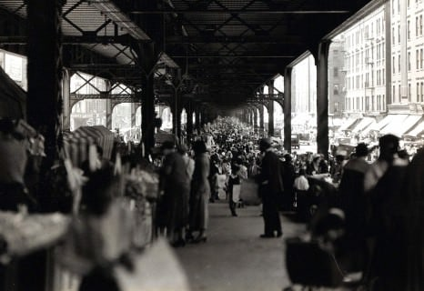 Packed street market under New York City Rail Road tracks, looking south on Park Ave from 123rd St,June 1932