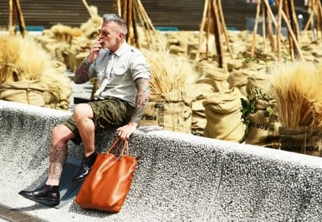 Nick Wooster in Shorts. with Bag