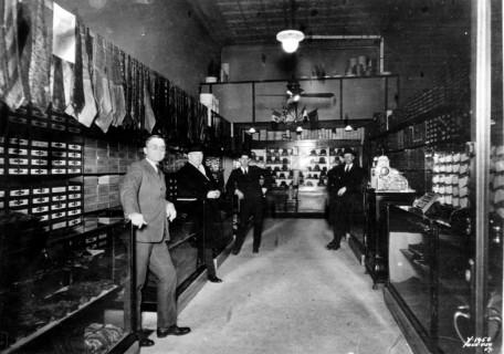 Harry S. Truman & in his haberdashery ca. 1921