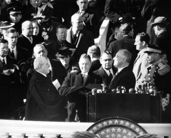 Chief Justice Charles Evans Hughes administering the oath of office to Franklin Delano Roosevelt on the east portico of the U.S. Capitol, January 20, 1941