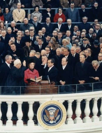 Chief Justice Earl Warren administering the oath of office to Richard M. Nixon on the east portico of the U.S. Capitol, January 20, 1969
