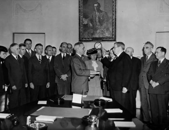 Chief Justice Harlan F. Stone administering the oath of office to Harry S. Truman in the Cabinet Room of the White House, April 12, 1945