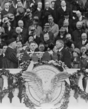 Chief Justice William H. Taft administering the oath of office to Herbert Hoover on the east portico of the U.S. Capitol, March 4, 1929