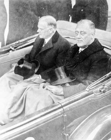 Franklin Delano Roosevelt and Herbert Hoover in convertible automobile on way to Capitol for Roosevelt's inauguration, March 4, 1933