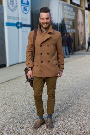 Mid brown Peacoat, skinny olive khaki pants, contrasting sockls