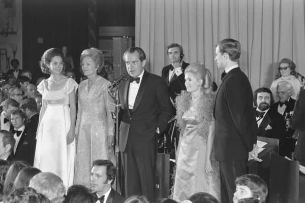 Nixon in black tie at the inaugurational ball with shawl collar tuxedo, cummerbund & studs