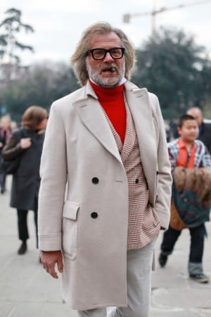 Off white overcoat with plaid sportscoat & red turtleneck sweater