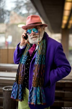 Over the top colorful outfit in green, purple & mirrored sunglasses with reading glasses