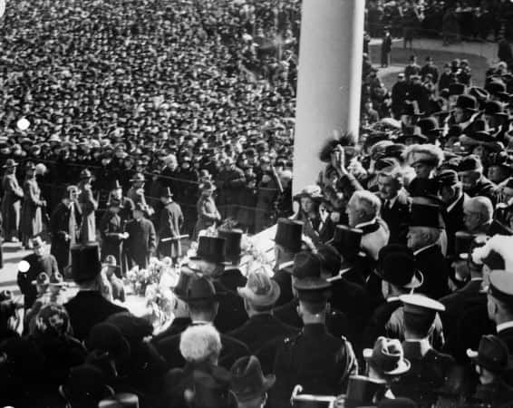 President Harding waving to crowd from inaugural stand on east portico of U.S. Capitol, March 4, 1921