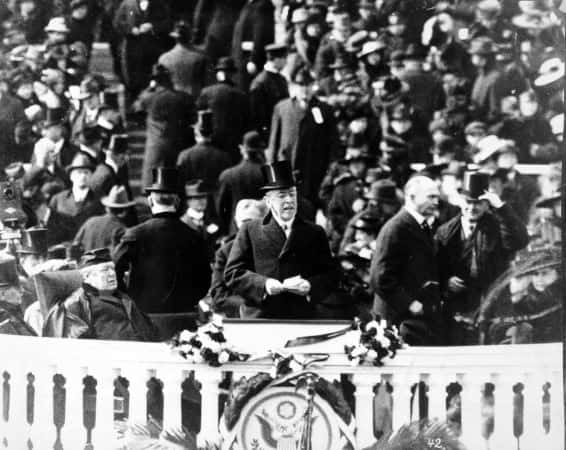 President Wilson, with top hat and speech in hand, delivering his inaugural address, March 5, 1917