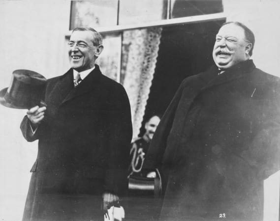 President-elect Wilson and President Taft, standing side by side, laughing, at White House prior to Wilson's inauguration ceremonies, March 4, 1913