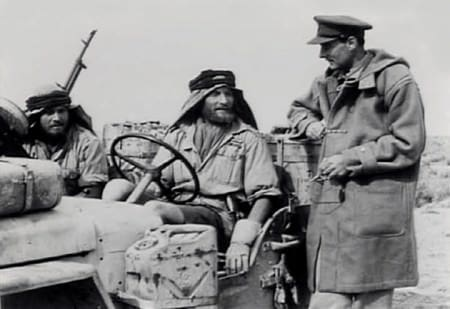 Sir David Stirling, founder of the SAS with Duffle Coat in the Desert