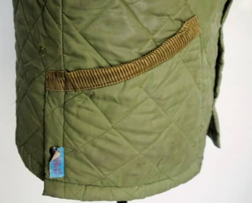 Husky quilted jacket side view with angled patch pockets & side vents