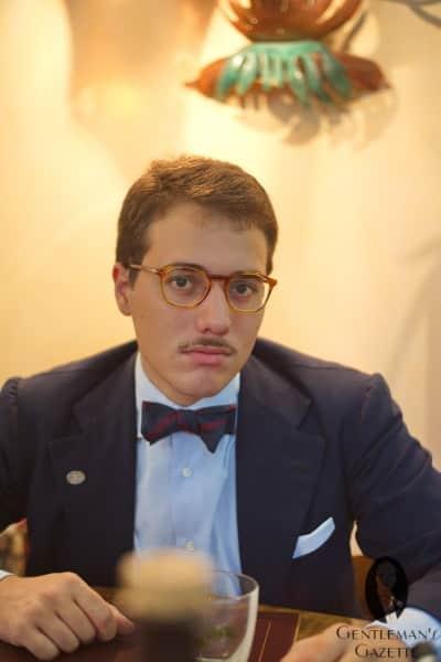Giuseppe with bow tie, mustache, & navy blazer