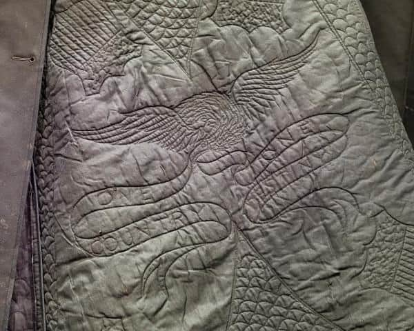 Heavy hand quilting of the coat Abraham Lincoln wore the night he was assassinated.