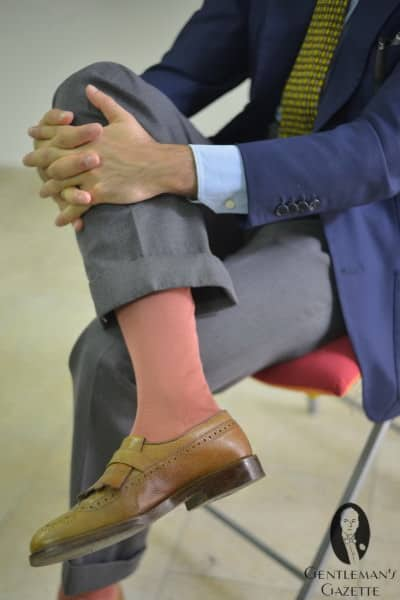 Salmon colored over the calf socks with cognac shoes