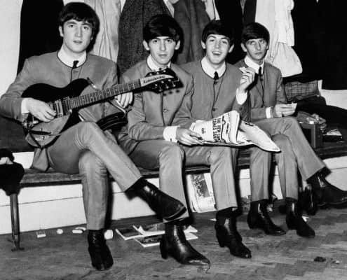 Beatles in collarless Nehru Jackets