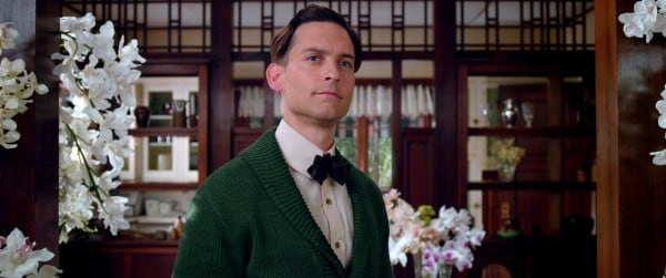 Nick Carraway in bow tie and green cardigan