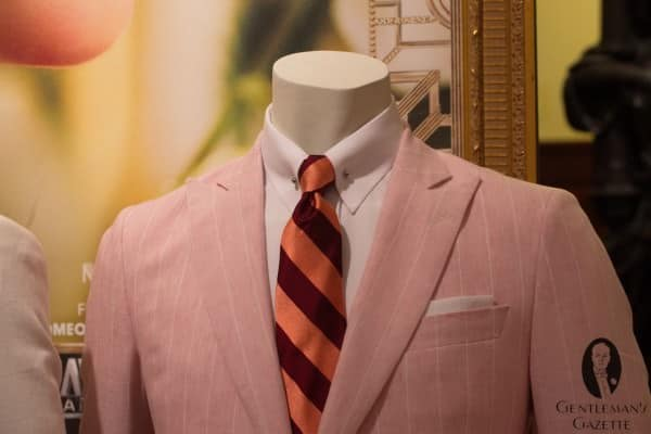 Pink linen suit close-up with repp tie & collar bar