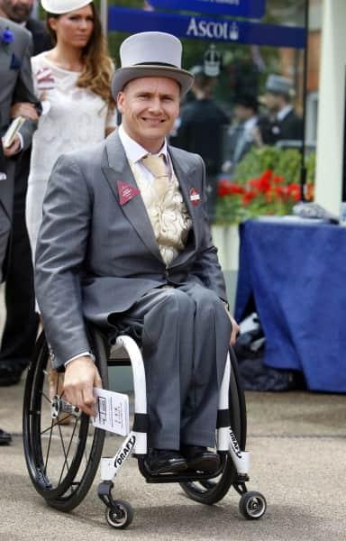 David Weir Durin in morning dress in a wheelchait