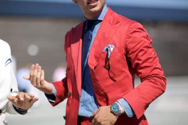 Davide Roberto Baroncini in red with cutaway collar navy knit tie & awkwarly high lapel buttonhole