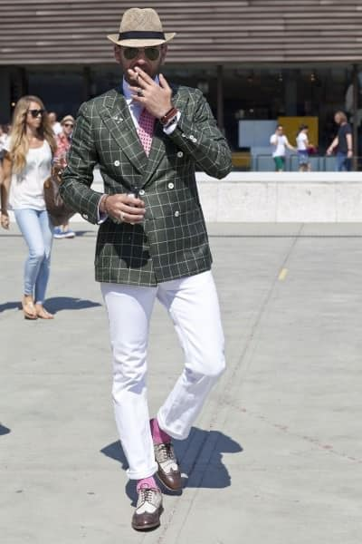 Olive green windowpane blazer, white trousers, pink socks and spectator shoes