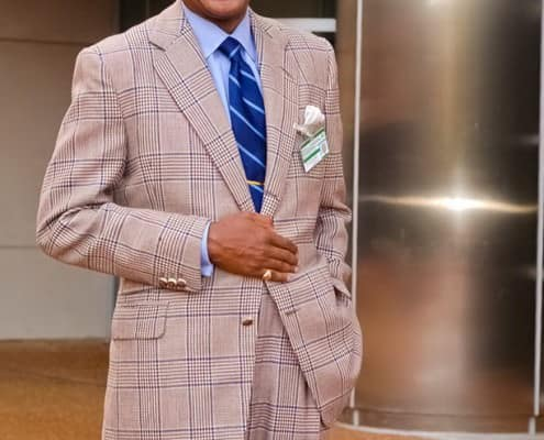 Dr. Andre Churchwell in beautiful plaid suit