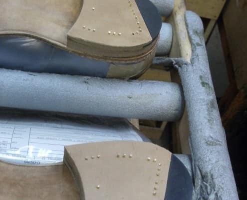 EG shoes have distinctively nailed heels. These await finishing.