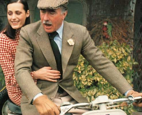 Luciano Barbera on a bike with boutonniere