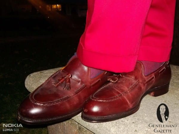 Oxblood Cordovan Tassel Loafers by Meermin, with red blue striped socks by Fort Belvedere & red Indochino slacks