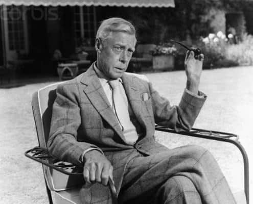 70 year old Duke of Windsor with buttoned jacket, large shirt collar and without tie dimple