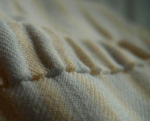 Hand stitching on the inside shoulder of the shoulder seam