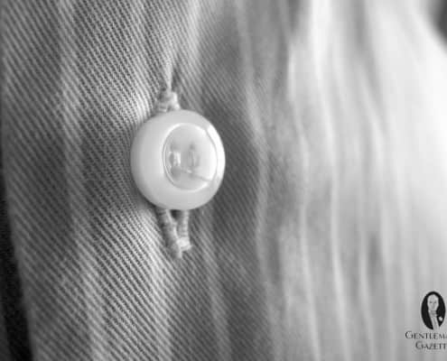Polyester button without Shank results in buttonhole wrinkles