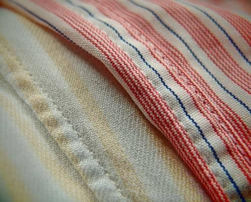 Single needle stitching on the left vs. double needle stitching on the right