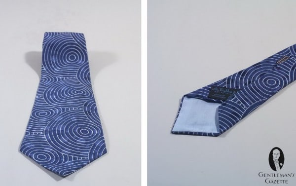 A Sulka Tie in Silk with circle and dots in blue, black & white