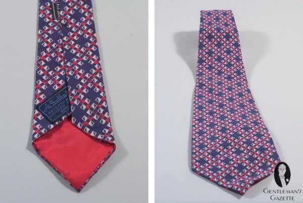 A. Sulka Printed silk diamond - check pattern on jacquard woven backgroung in nav, red & white