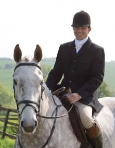 Black Hacking Jacket with ghillie collar, stock and stock pin with tattersall vest, breeches and riding boots