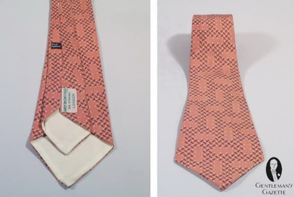 Orange printed silk tie with white and blue pattern by Savoy Taylors Guild London