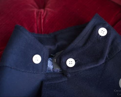Throat tab hidden underneath collar