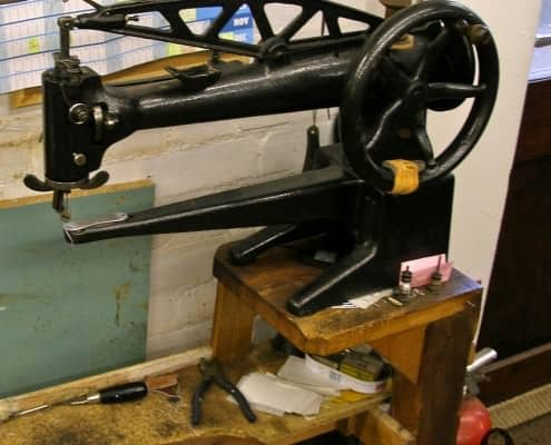 A hand-powered sewing machine