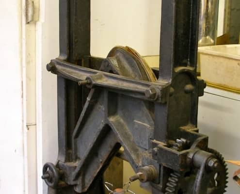 A press for shaping the uppers