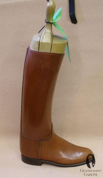 A tan riding boot