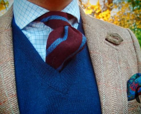 Alpaca sweater vest in blue with wool tie and paisley pocket square by Fort Belvedere